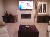 Coffee table and entertainment cabinets on either side of TV