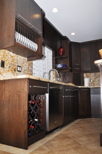 Completely Custom Built Kitchen with wine and dinner ware racks.